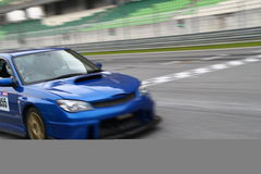 Blurred car finishing race Royalty Free Stock Photography