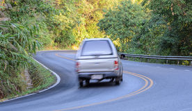 Blurred car on the forest road Royalty Free Stock Photo