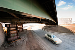 Blurred car moving under an old bridge Stock Images