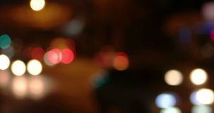 Blurred carlights irban traffic in a night time stock footage