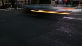 Blurred cars in busy traffic rush hour in a city intersection stock video footage