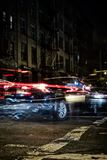 Blurred cars at night in Soho, Manhattan, New York stock images