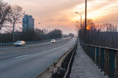 Blurred cars on a road. In Sosnowiec in Poland at sunset Stock Photography
