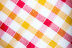 Blurred checkered fabric background. Blurred colorful checkered fabric background texture 1 Royalty Free Stock Photos