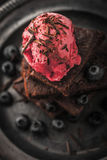 Blurred chocolate brownie with blueberry  and ice cream on the vintage plate vertical Stock Image
