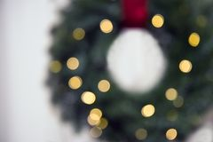 Blurred Christmas background with illuminated by garland wreath stock photo