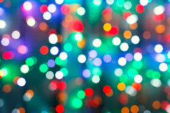Blurred christmas illumination in dark night stock photography