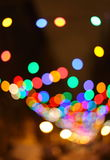 Blurred christmas lights background. Christmas Background. Holiday glowing Abstract Defocused Background With Blinking lights. Blurred Bokeh Stock Photography