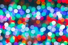 Blurred christmas lights in dark night Royalty Free Stock Photo