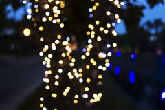 Christmas lights blurred on city streets. Blurred Christmas lights gracing the night streets of the city Royalty Free Stock Photography