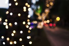 Christmas lights blurred on city streets. Blurred Christmas lights gracing the night streets of the city Royalty Free Stock Photos