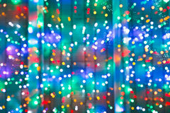 Blurred christmas lights on window. In night royalty free stock image