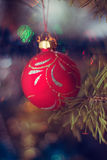 Blurred Christmas toy on Year tree, bokeh, soft focus, background art, the author's processing.  Stock Photography