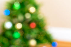 Blurred Christmas tree and gift boxes background Stock Photo