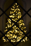 Blurred Christmas tree and grating. Stock Photo
