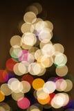 Blurred Christmas tree lights. Stock Photos
