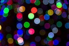 Blurred Christmas Tree Lights. On a dark background Stock Photo