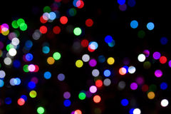 Blurred Christmas Tree Lights. On a dark background Stock Images