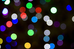 Blurred Christmas Tree Lights. On a dark background Royalty Free Stock Photography