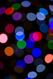 Blurred Christmas Tree Lights. On a dark background Royalty Free Stock Image