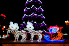 Blurred christmas tree lights. On black background Stock Photos