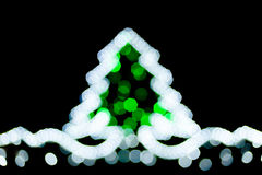 Blurred christmas tree lights. On black background Stock Photography
