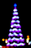 Blurred christmas tree lights. On black background Stock Images