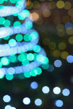 Blurred christmas tree lights in vertical frame Stock Photography