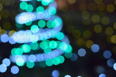 Blurred christmas tree lights in vertical frame Stock Photos