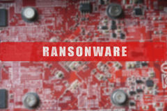 Blurred of a circuit board with big microchip . Cyber security concept with ransonware. Text Stock Photography