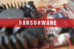 Blurred of a circuit board with big microchip . Cyber security concept with ransonware. Text Stock Photo