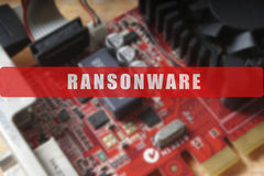 Blurred of a circuit board with big microchip . Cyber security concept with ransonware. Text Royalty Free Stock Photo