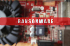 Blurred of a circuit board with big microchip . Cyber security concept with ransonware. Text Stock Photos