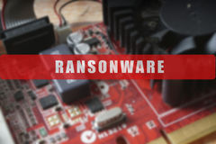 Blurred of a circuit board with big microchip . Cyber security concept with ransonware. Text Royalty Free Stock Photography
