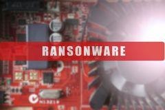 Blurred of a circuit board with big microchip . Cyber security concept with ransonware text. Blurred of a circuit board with big microchip . Cyber security Royalty Free Stock Images