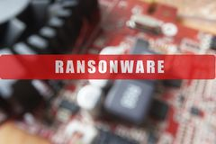 Blurred of a circuit board with big microchip . Cyber security concept with ransonware text. Blurred of a circuit board with big microchip . Cyber security Stock Photography
