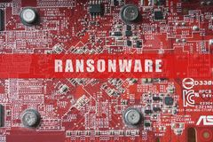 Blurred of a circuit board with big microchip . Cyber security concept with ransonware text. Blurred of a circuit board with big microchip . Cyber security Royalty Free Stock Photos