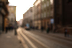 Blurred city background the street of old town at sunset Royalty Free Stock Image
