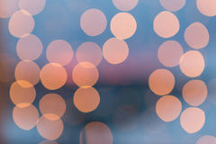 Blurred city light spots at dusk Stock Image