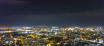 Blurred city lights bokeh. Aerial view urban night light bokeh. Stock Images