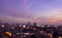 Blurred city lights bokeh illuminate at twilight Royalty Free Stock Image
