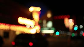 Blurred City Lights with Traffic Moving in Urban Downtown Reno Nevada. Blurred City Lights with Traffic Moving in Urban Downtown Reno Nevada at Night stock footage