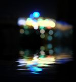 Blurred city at night, bokeh background. Stock Images