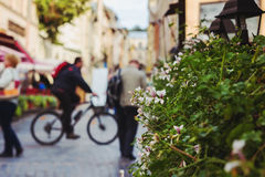 Blurred city and people urban scene, focus on foreground Stock Photo