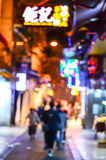 Blurred city shopping and people urban scene. At night Stock Images