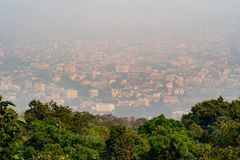 A blurred cityscape of Chiang Mai during burning season. stock photos