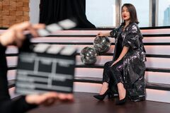 Blurred Clapper Board And Woman Actor On Stage. Movie Or Clip Production Backstage. Singer Super Star Near Discoballs