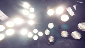 Blurred close up of two working surgical lamps. 4K stock footage