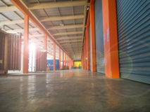 Blurred Closed warehouse. Or storehouse background with some people Stock Photography