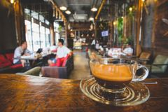 Blurred coffee shop. Blur or Defocus image of Coffee Shop or Cafeteria for use as Background Royalty Free Stock Photos